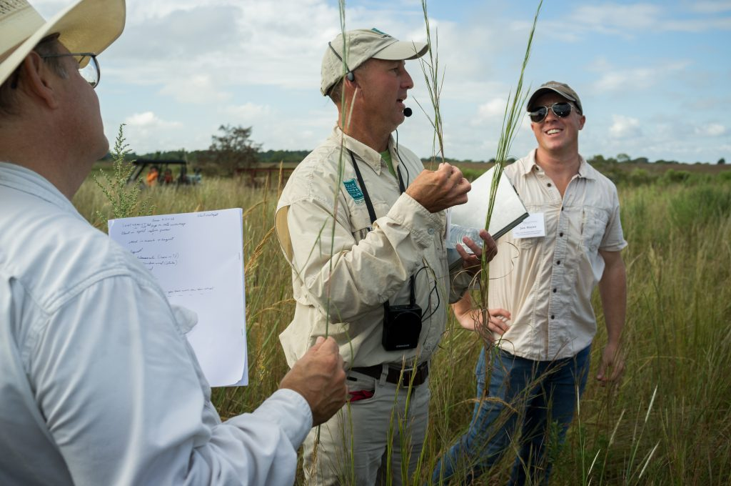 Identifying native prairie grasses with Jason Singhurst (pictured in the middle)