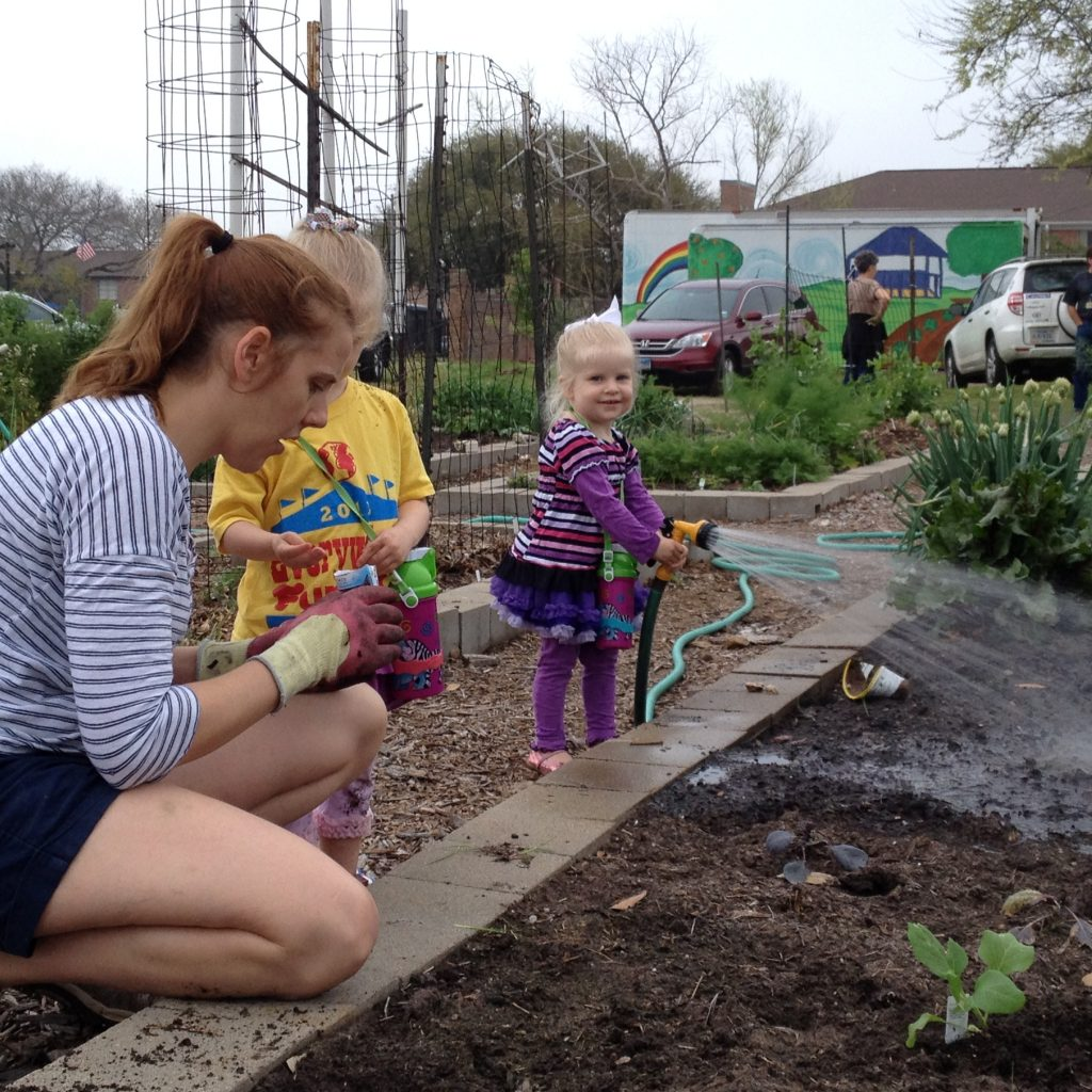 A WCG member teaches her kids that we grow food by planting seeds.