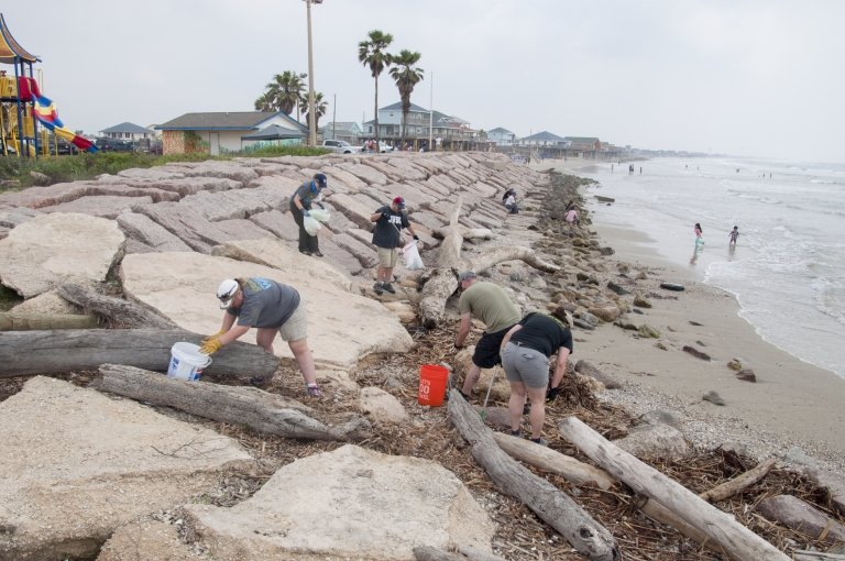 Volunteers participate in a monthly cleanup at Surfside Jetty in Freeport, Texas